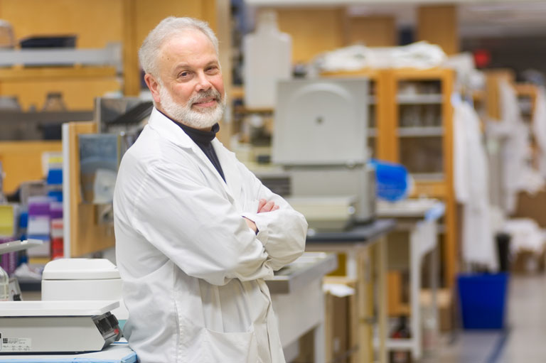 Dr. Neil Cashman in his lab Credit: Martin Dee